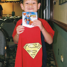 A proud Oscar Spangler and his new Superman cape.