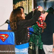 Film & Television Historian John Field receives a lei from Vicky DeSantos.