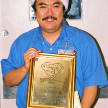 Steven Kanzaki displays his award which includes a gift certificate to Tower Records.