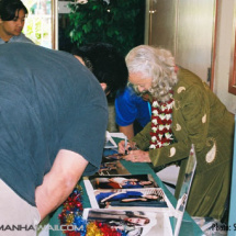 Noel Neill signs autographs for her fans.